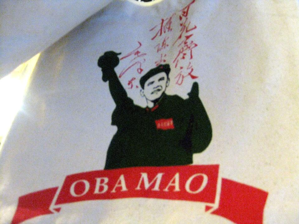 """A canvas bag bearing a typical image of Mao propaganda, merged with Obama's face and name. References to Obama and America crop up in many random places. There is even a club named """"Obama Club."""""""