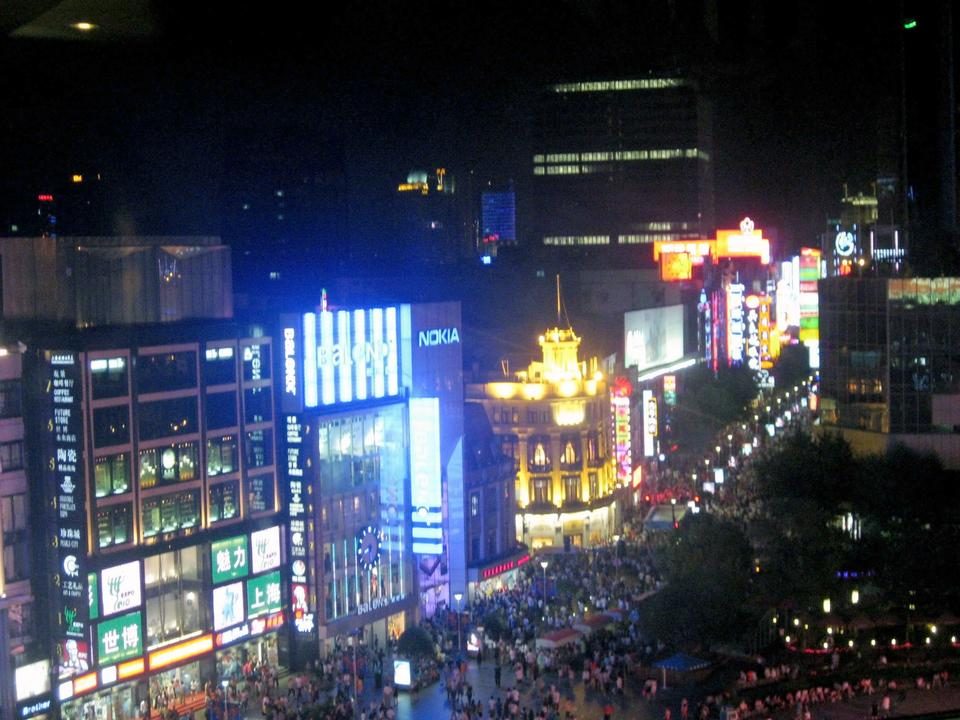 Nanjing Road East, a glitzy pedestrian walkway crowded with shops, restaurants, and tourists.