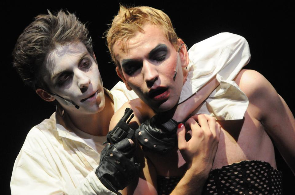 """Riff Raff (Philip M. Gillen '13) threatens Dr. Frank N. Furter (Roy A. Kimmey III '09) in an effort to return to his home of Transsexual, Transylvania in """"The Rocky Horror Show."""