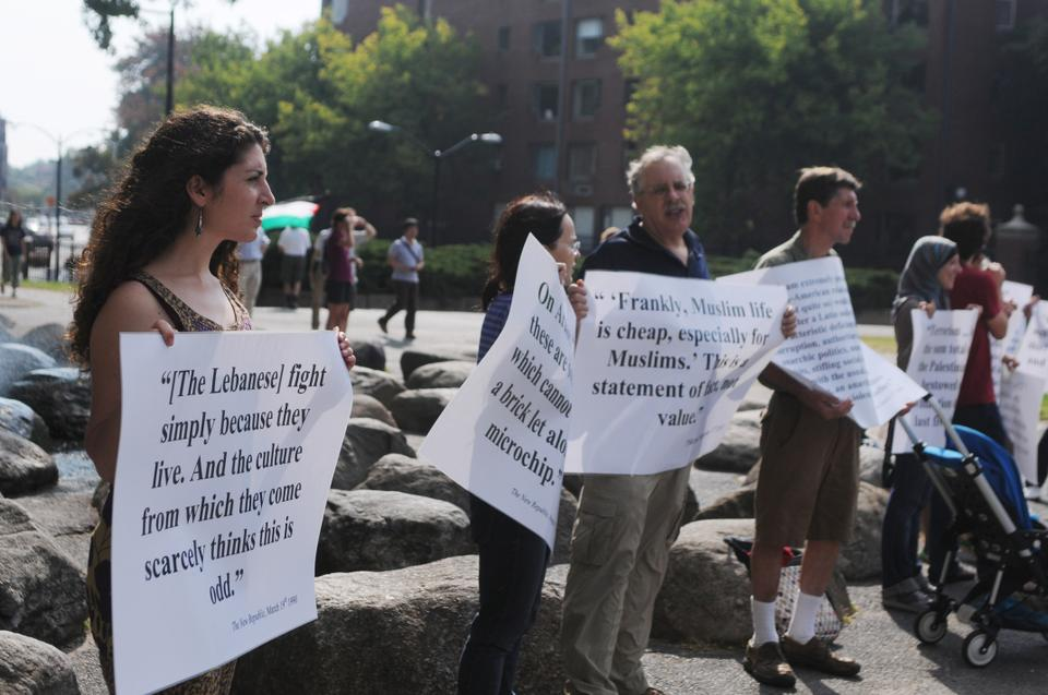 Students and affiliates of Harvard University hold signs with quotes by Martin Peretz in front of the Science Center on Saturday morning in protest against the Social Studies Committee's decision to honor Peretz.