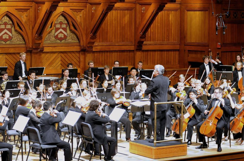 """Bruce Hangen conducts the Boston Conservatory Orchestra in a performance of Debussy's """"Iberia"""" in Sanders Theater, Memorial Hall on Sunday afternoon."""