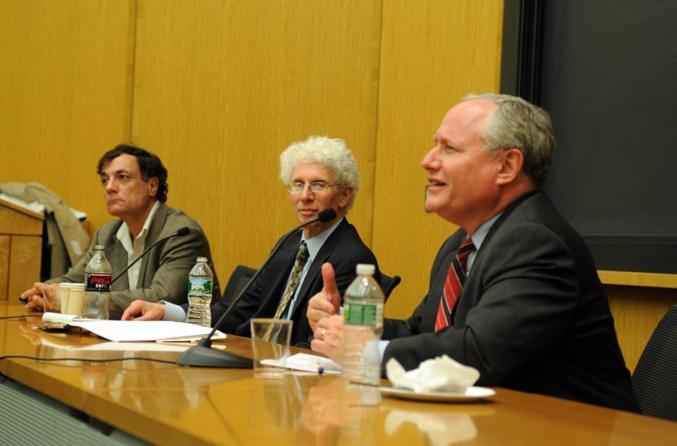 Political analyst Bill Kristol (right) and William A. Galston (center) of the Brookings Institute discuss the implications of Tuesday's elections for American politics.