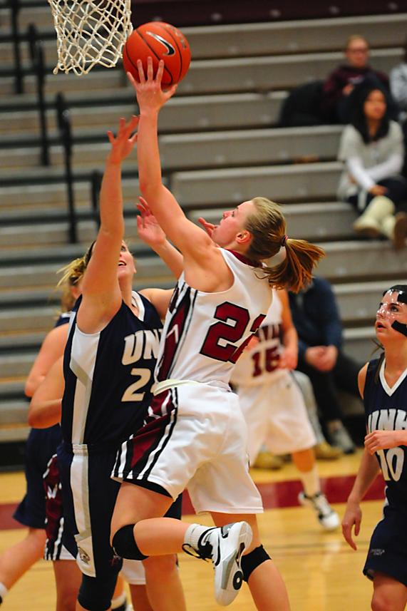 Harvard freshman Christine Clark, shown here in earlier action against UNH, was one of five players in double digits against Boston College. The Crimson lost the matchup, 80-78.