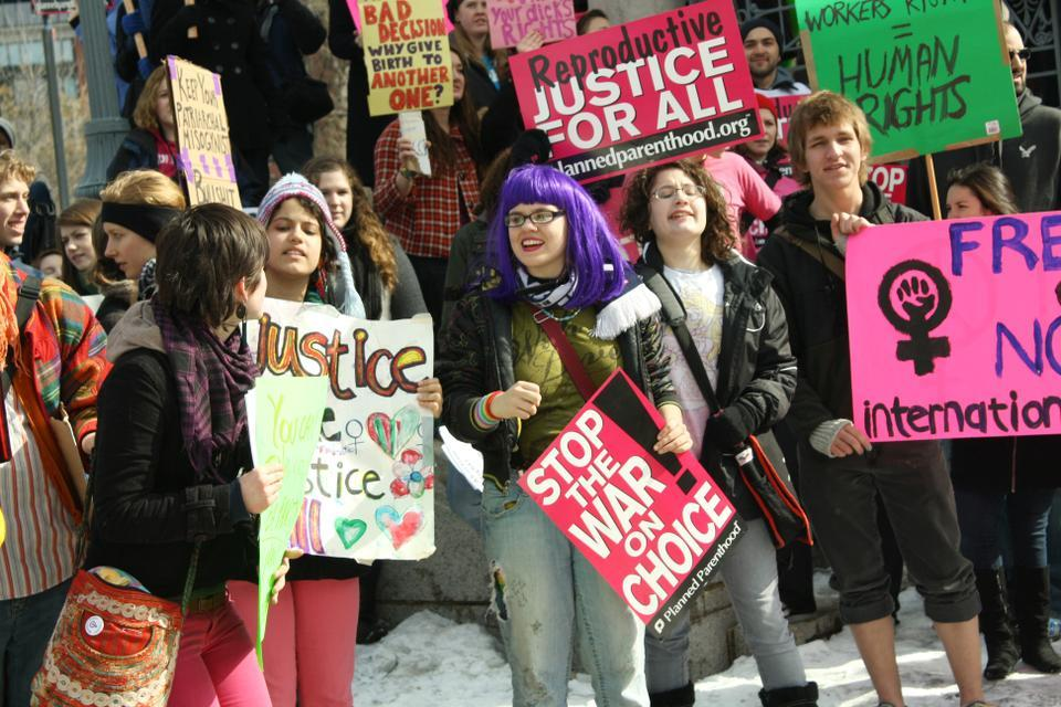 Members of the Radcliffe Union of Students, Harvard Students for Choice, and other Harvard students join area pro-choice supporters in a walk to the Massachusetts State House to rally against Congress' slash of funding for Planned Parenthood and other women's health initiatives.