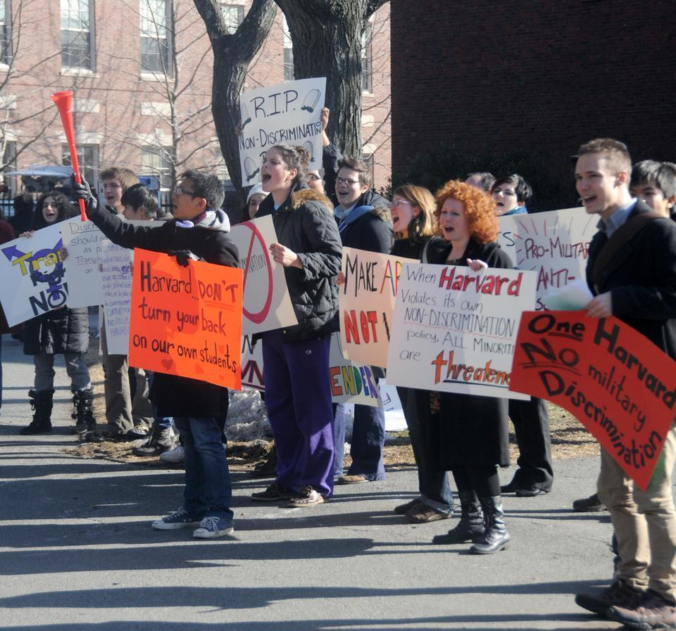 Students protest outside Loeb House where President Faust signed an agreement to bring ROTC back onto Harvard's campus. Trans students are are still prohibited from participating in ROTC programs.