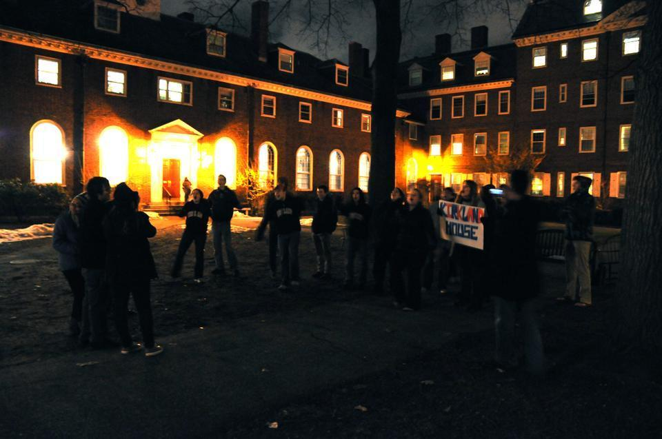 A freshmen blocking group huddles together in the Kirkland courtyard as current residents of the House cheer them on. Freshmen braved the cold to carry on the Housing-Day Eve tradition of River Run.