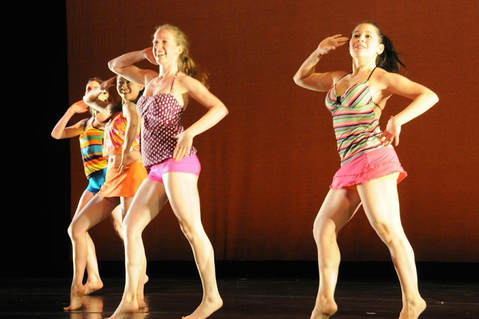 """After winter's passing, dancers welcome in spring and summer. Amanda Hameline '12, Charlotte Chang '14, Mackenzie Dolginow '13, and Jun Shepard '14  perform in beachwear in the second half of """"sprangsprungspring,"""" a routine complete with music of the tropics and sunny lighting."""