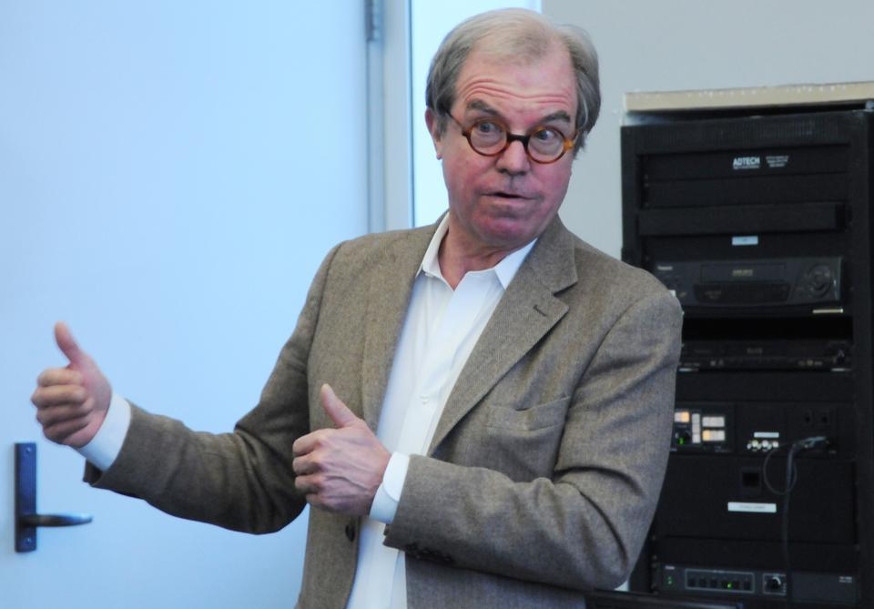 Nicholas Negroponte, founder of One Laptop Per Child, discusses his social enterprise company and the difficulties it has encountered before an audience of student leaders in Harvard Hall.