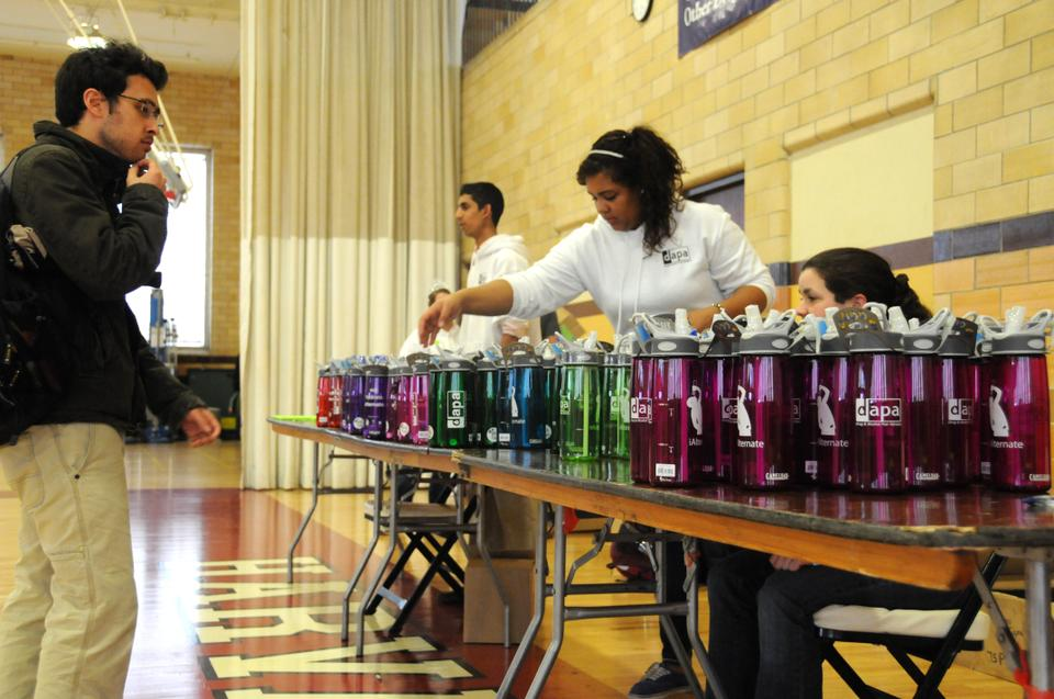 "Students receive a free DAPA Camelbak water bottle featuring their new design ""iAlternate"" after participating in the National Alcohol Screening Day"