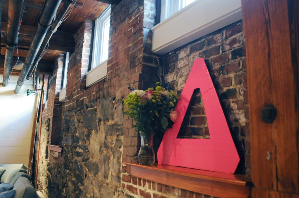 The Delta Gamma sign sits on display in the new DG House.