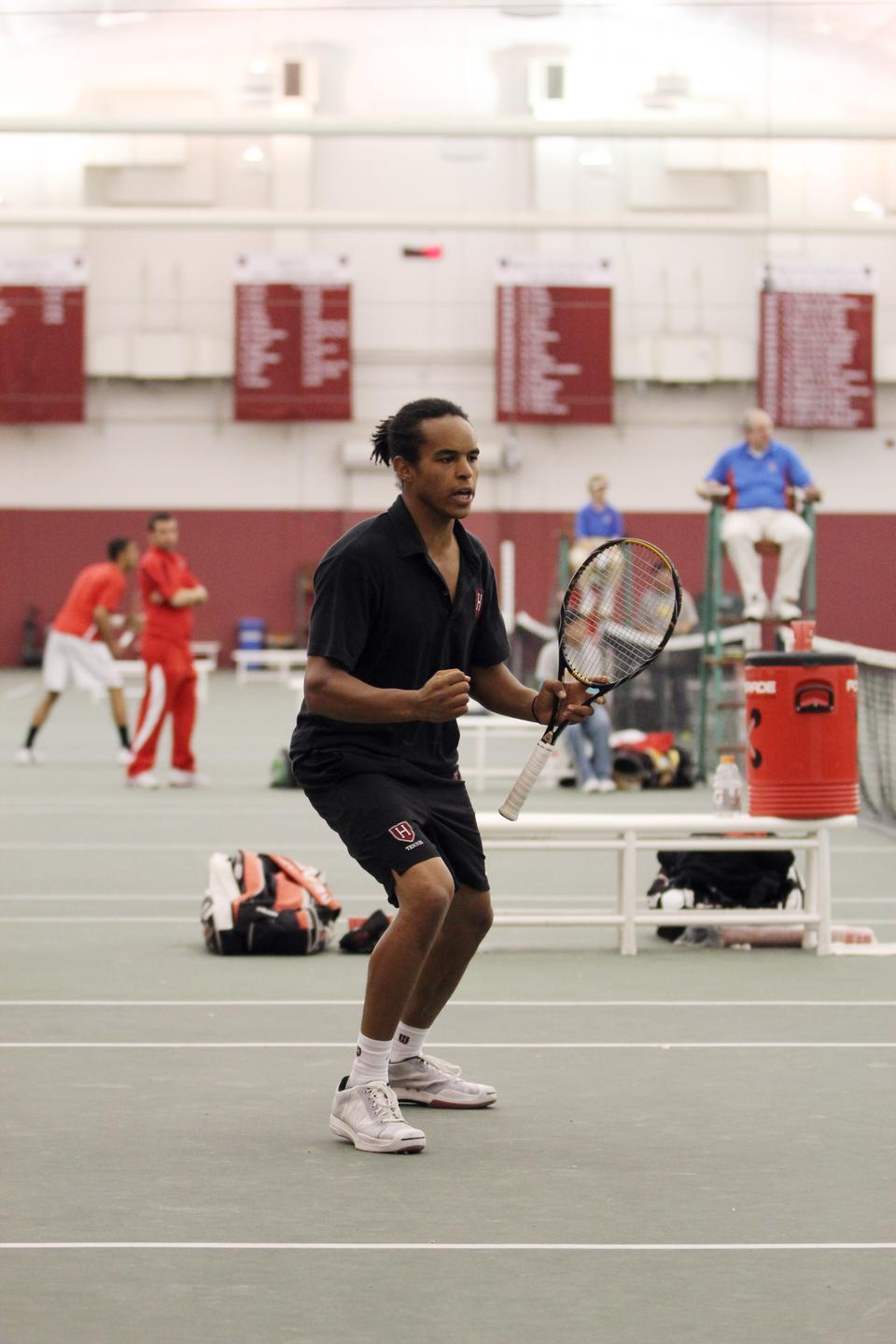 Though he and Casey MacMaster lost twice at the top doubles position, captain Aba Omedele-Lucien—shown here in previous play—took down the No. 2 singles player of both Penn and Princeton this weekend. Harvard pulled away for a 5-2 win against the Quakers Saturday but lost yesterday to Princeton.