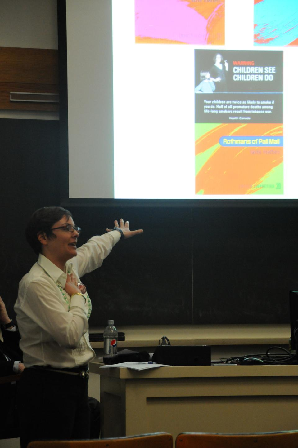 Gigi Kellett, a representative from Corporate Accountability International, presents at yesterday's Tobacco Control panel in Emerson Hall. The event was hosted by the Harvard Undergraduate Global Health Forum.