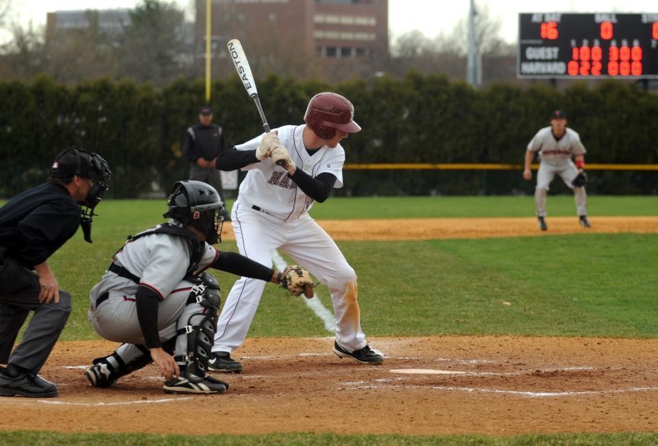 Freshman shortstop Jake McGuiggan, shown here in earlier action, whose play was one of the Crimson's few bright spots yesterday, had two of the team's three hits in the first matchup against Bryant.