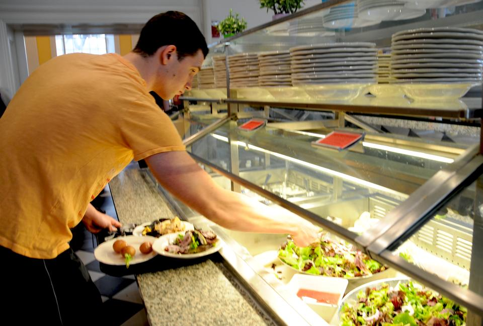 Stefan V. Mihaylov '11 tries a salad of organic mixed field greens, shaved red onions, toasted walnuts, sundried cranberries, and Vermont goat cheese at Lowell Dining Hall last night.  All dining halls served Sustainable Dinner in celebration of Earth Day 2011.