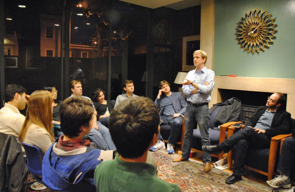 Facebook co-founder Chris R. Hughes '06 discusses his new project, Jumo, a social networking site for non-profit organizations, in the Quincy House senior common room.