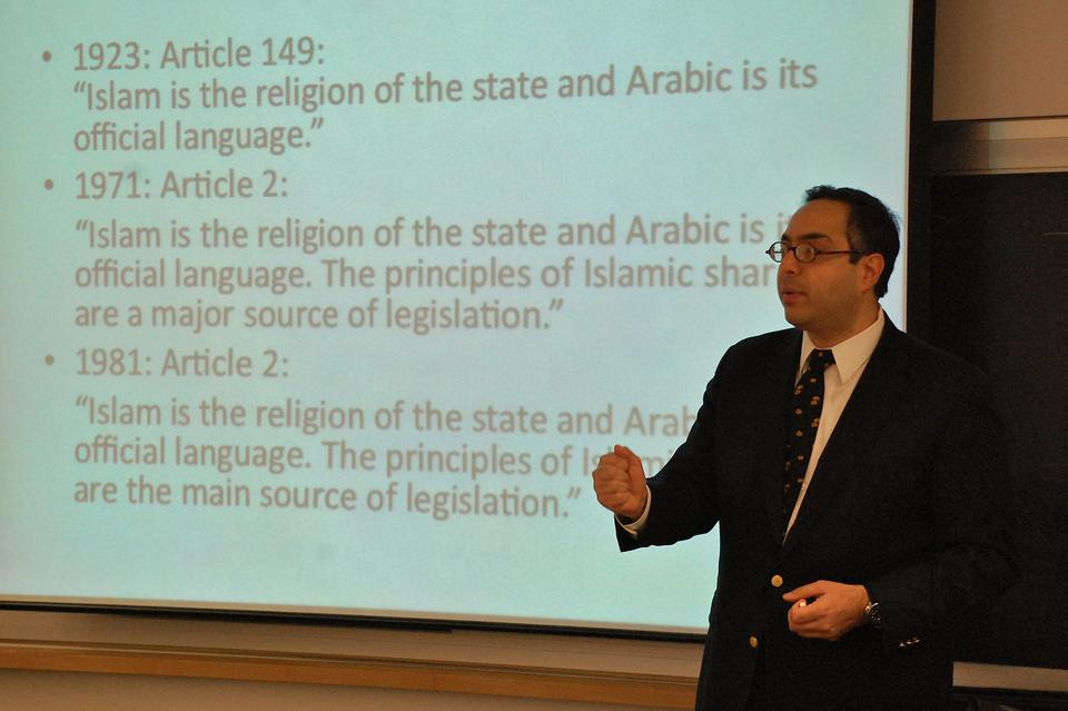 Tarek Masoud, Assistant Professor of Public Policy, Ash Center for Democratic Governance and Innovation, John F. Kennedy School of Government, gives a brief history of the role of Islam and Sharia Law in the Egyptian Constitution, an important issue in upcoming elections, during his presentation in the Bowie-Vernon Room of CGIS on Thursday.
