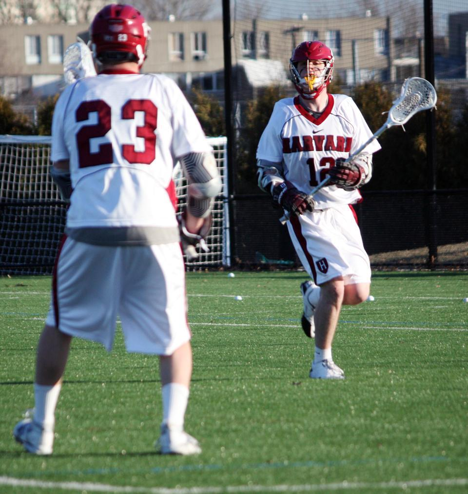 The team's second-leading scorer, co-captain Dean Gibbons—shown here in earlier action—poured in three goals along with three assists to lead the Crimson over Princeton, 9-8, on the road Saturday afternoon. The crucial come-from-behind victory kept Harvard in contention for a berth in the Ivy League Tournament, to be held at Cornell May 6-8.