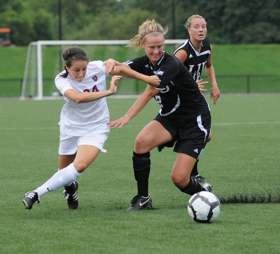 Rookie Elizabeth Weisman, shown above in earlier action, had a standout performance for the Crimson against the Irish women's national team on Friday. Harvard was first to strike thanks to junior Rebecca Millock's goal, and junior Sophie Legros hit the game-winner to set the final score, 2-1.