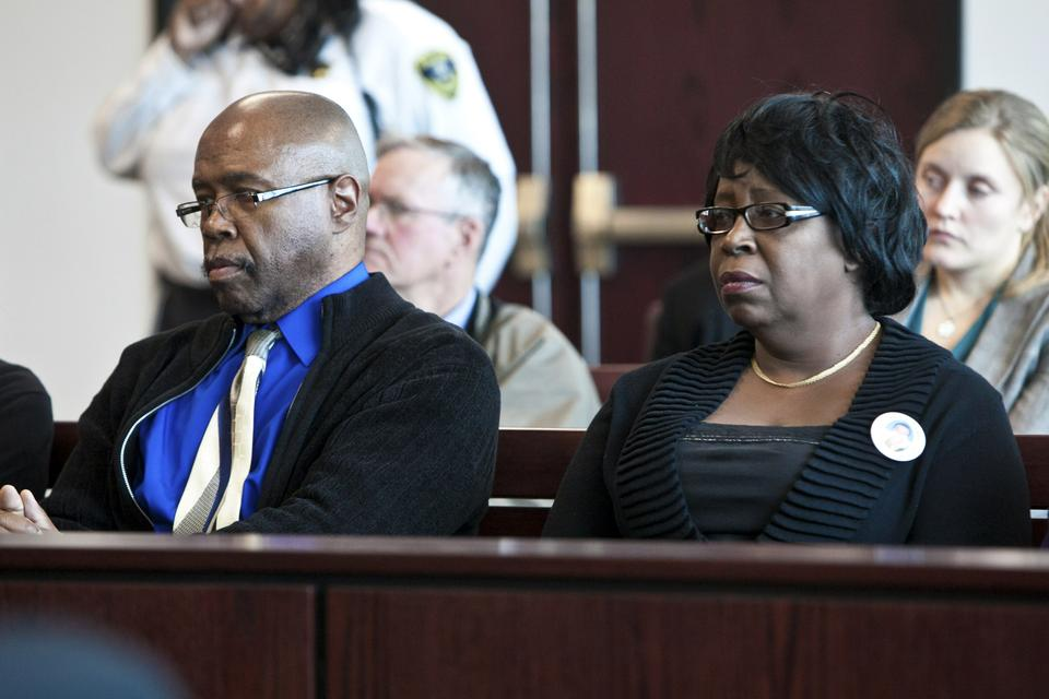 Gregory Daniel Cosby and Denise Cosby, the uncle and mother of murder victim Justin Cosby, look on from the front row of the courtroom as the jury foreperson announces the verdict.