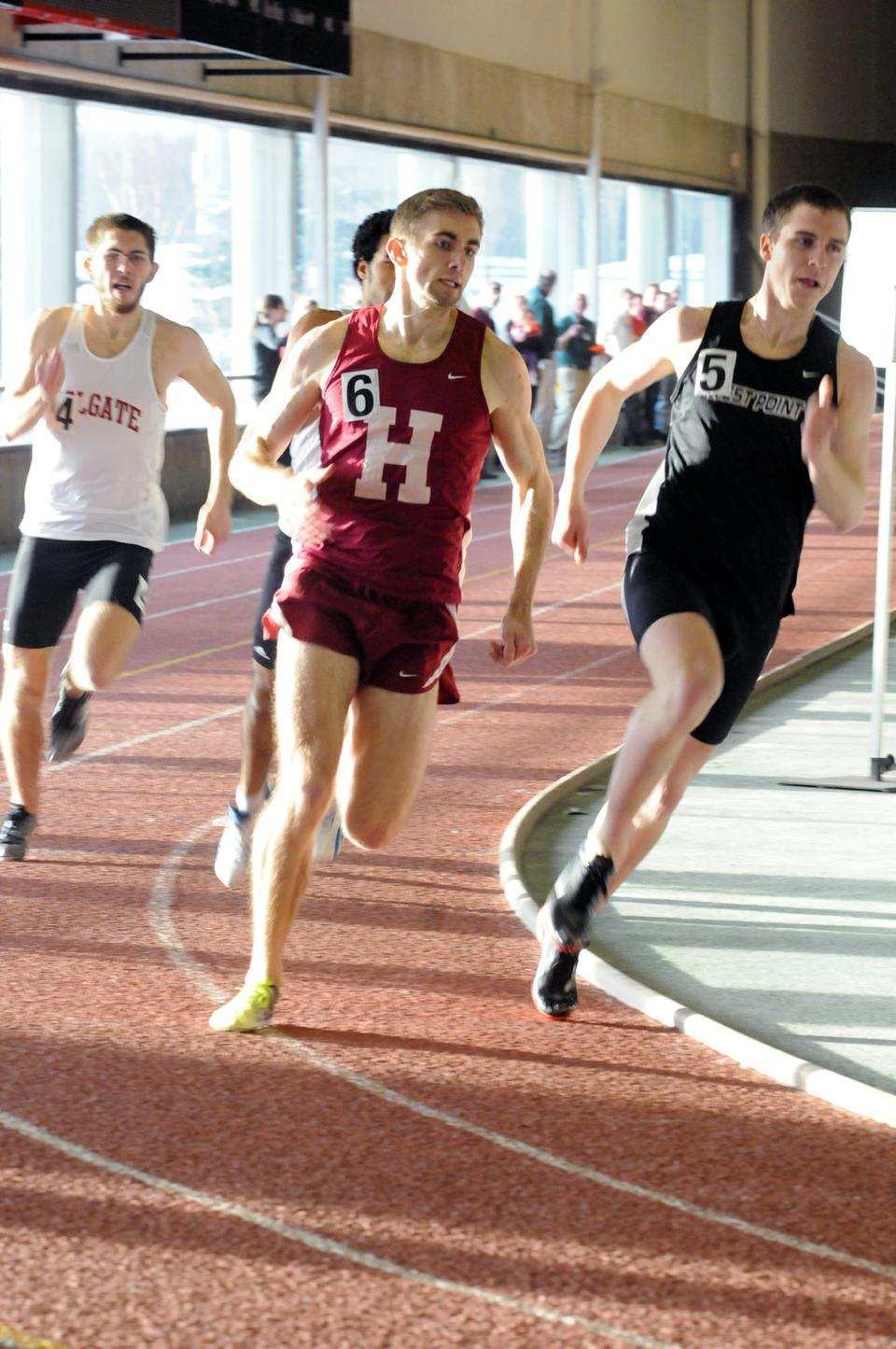 Track & field co-captain Brian Hill, shown here in earlier action, anchored the Crimson's 4x800 relay team Saturday at the Penn Relays. Hill turned in a personal best to lead Harvard's entry—composed of juniors Darcy Wilson and Brian Paison and sophomore Weishen Mead—to a new school record.