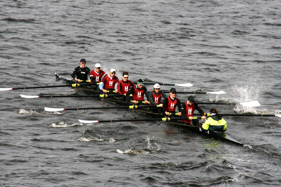 The Harvard lightweight first varsity eight, shown here in earlier action, defeated Princeton on the Charles this weekend in a battle of top-ranked crews. With the victory, the Crimson moves into first place.