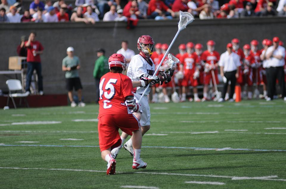 Co-captain Dean Gibbons, shown above in earlier play, was a key player in the team's win against Penn on Friday but could not lead his team to victory against the Big Red on Sunday. Cornell's offense picked up the pace in the second period, after junior co-captain Kevin Vaughan was called for a non-releasable illegal equipment penalty, and never looked back.