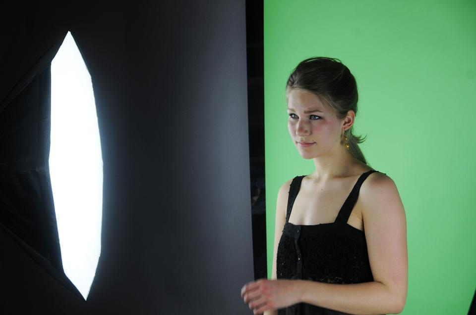 """Rina A. Kuusipalo '14 poses for a photoshoot during production for Fifteen Minutes Magazine's annual """"Fifteen Hottest Freshmen""""  issue."""