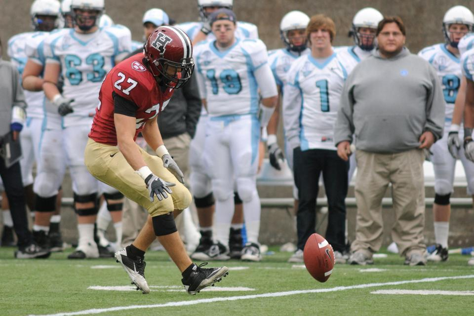 Collin Zych '11, shown here during his Harvard years, was recently cut from the Dallas Cowboys' regular season roster. Despite also working in finance, he maintains a shot at making the team's practice squad.