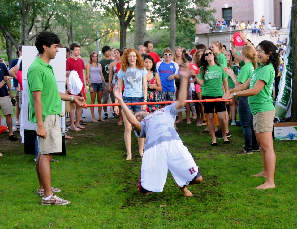 """Students play """"Eco Limbo"""" on Friday in Tercentenary Theater as part of """"Cape Crimson,"""" this year's welcome back event for students."""