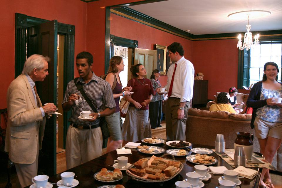 Students, staff, and other members of the Harvard community converse and enjoy tea and treats during Wednesday Tea at Sparks House, a tradition started by the late Rev. Prof. Peter Gomes.