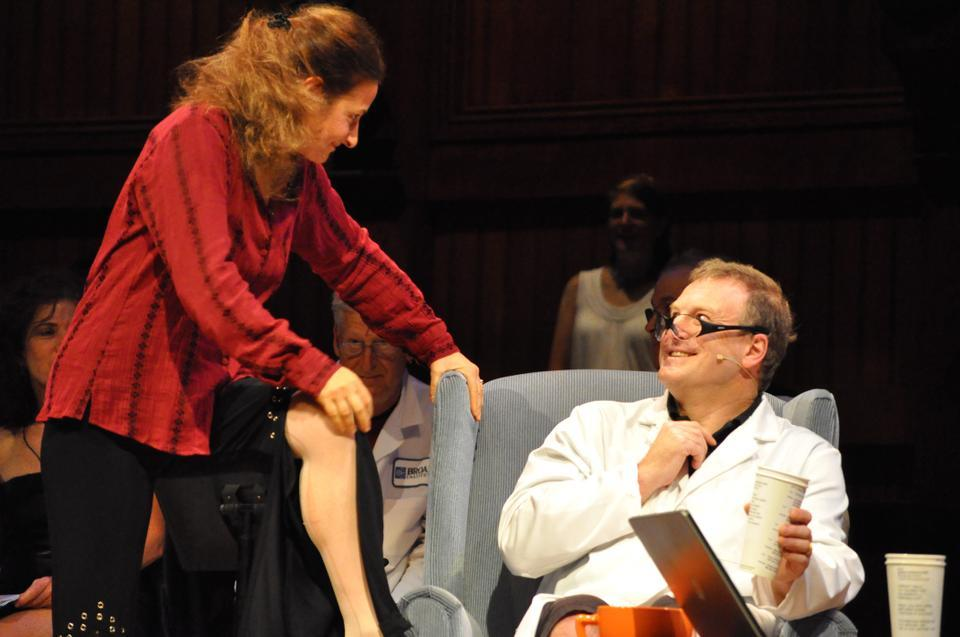 "Maria Ferrante seduces Daniel Rosenberg with a song about caffeine during ""Chemist in a Coffee Shop: A Mini-Opera in 5 Acts"" at the chemistry themed 21st annual Ig Nobel Prize Ceremony in Sanders Theatre on Thursday."