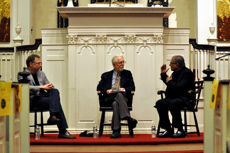 Harvard Divinity Professor Harvey Cox takes a central, moderating position between physicist and Caltech Professor Leonard Mlodinow in grey and Dr. Deepak Chopra at First Parish Church Wednesday night to discuss the War of the Worldviews: Science vs. Spirituality, the book Mlodinow and Chopra recently co-authored.