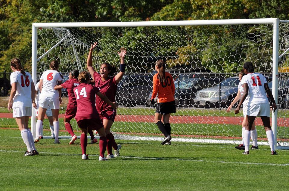 Junior midfielder Aisha Price scores Harvard's first goal against Cornell on Saturday afternoon. The matchup between the two teams ended in a deadlock, 2-2.