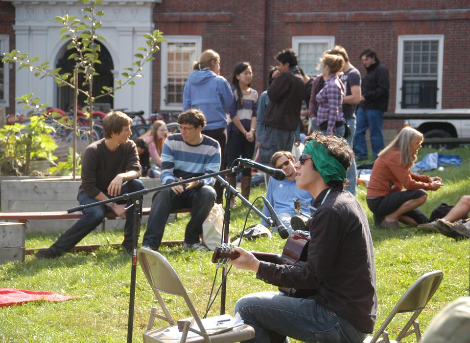The 2nd annual Harvest Festival is held Saturday afternoon in the Harvard Community Garden by Lowell. The festival featured performances, fresh squeezed apple juice, and sunshine.