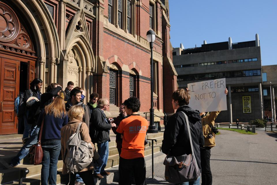 Students stand outside Sanders Theater after leaving Economics 10 in protest of the curriculum.