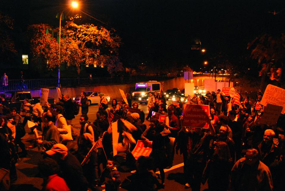 Protesters block traffic on Cambridge Street as they march to Harvard Law School on Wednesday night.