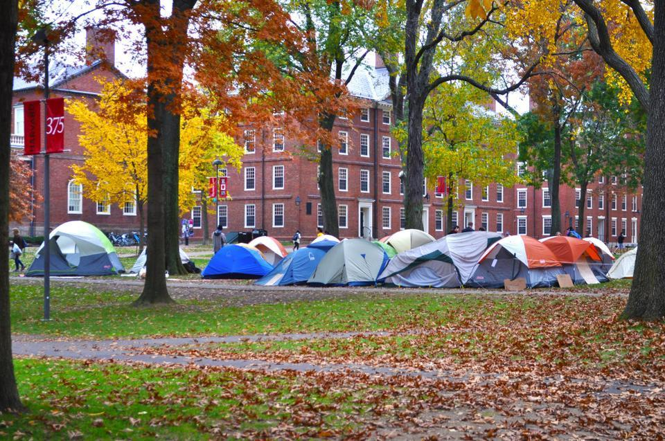 There is an eerie silence around the colorful tents and fall leaves at the Occupy Harvard movement in Harvard Yard on Thursday morning.
