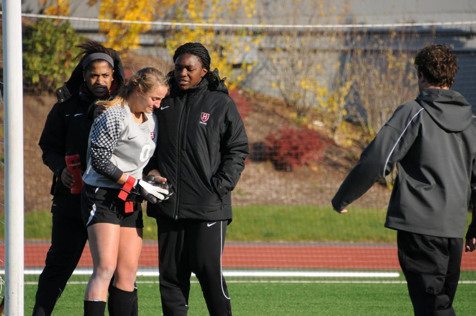 Freshman Cheta Emba (right) and sophomore Jessica Wright console fellow goalkeeper Bethany Kanten after the Crimson's 3-0 loss to BU in the first round of the NCAA tournament. The rookie starter recorded four saves.