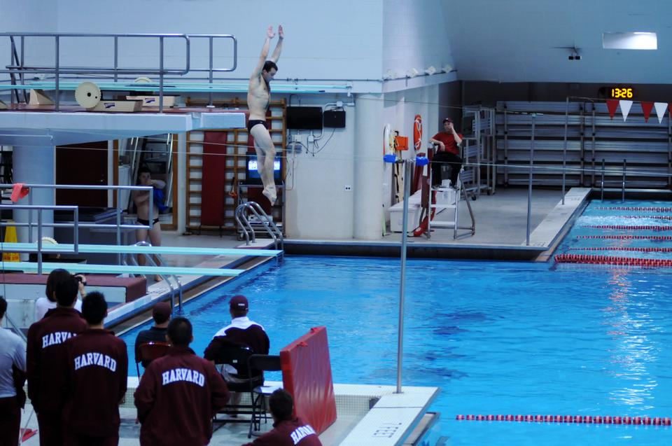 The Crimson's men's diving team faced off against Texas A & M this Friday at the Blodgett pool. A Harvard diving team member starts his dive.