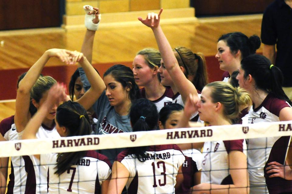 The volleyball team gathers together at the end of a game against Yale on Friday.