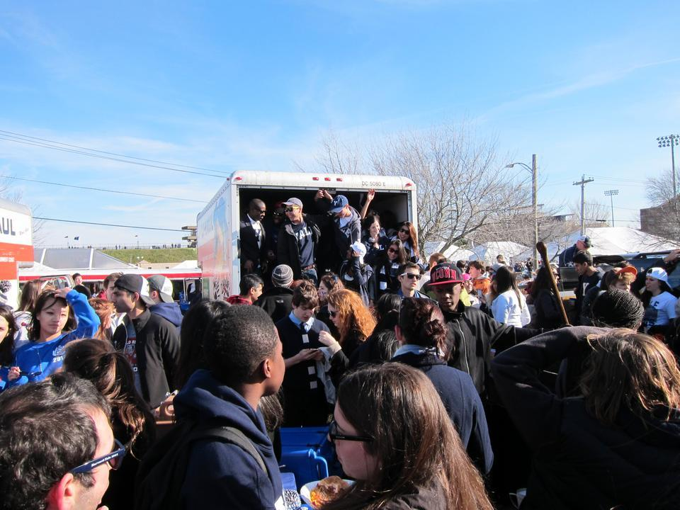 Tailgaters enjoy food and alcohol in U-Hauls parked outside of the Yale Bowl.