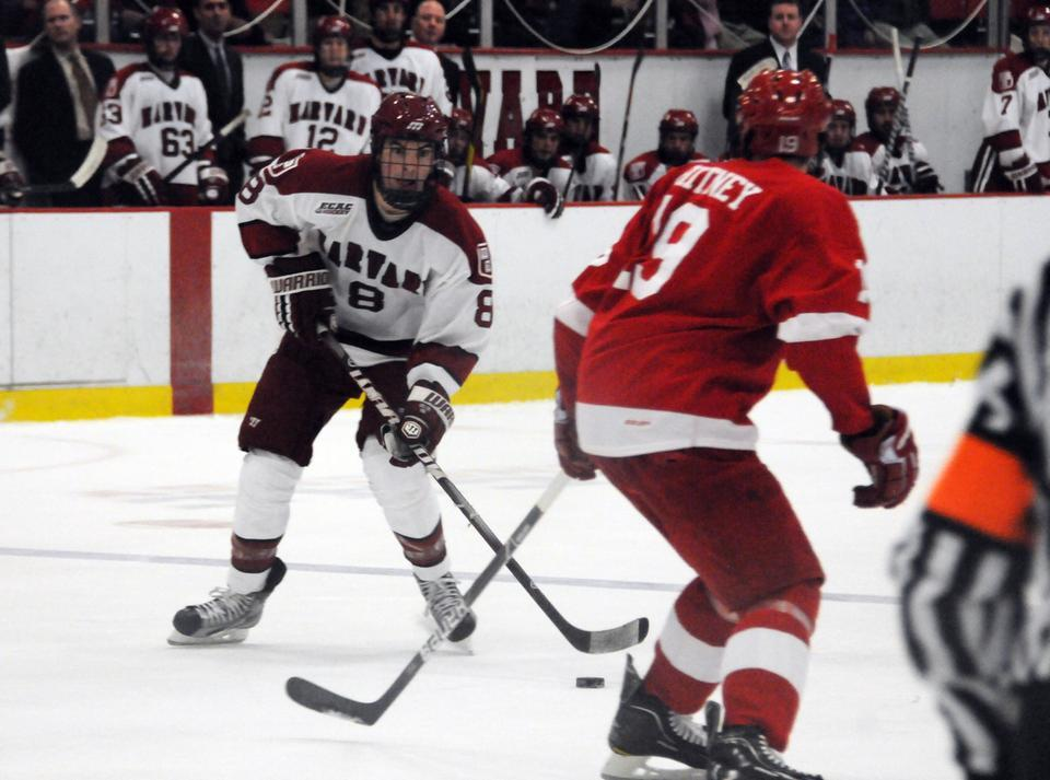 Rookie Patrick McNally, shown above in previous action, had three assists on the weekend. Senior Danny Biega contributed two helpers to the Crimson's tie with University of Massachusetts Amherst Friday night. Though Harvard fell behind multiple times, the Crimson found ways to come back, 4-4.