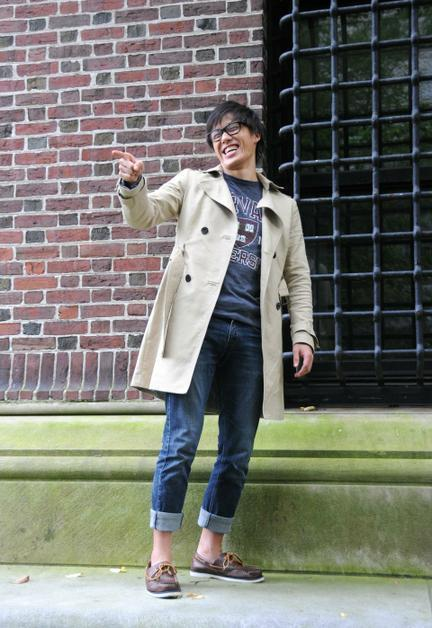 In this file photo taken for a Crimson magazine issue earlier in the semester, Abe Liu poses near Widener Library, showing off his taste of fashion. Liu was apprehended by police on Thursday.