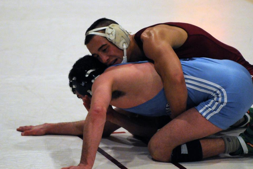 Co-captain Corey Jantzen, shown here in earlier action, returned from injury Friday to wrestle for the first time since last January. The senior won both of matchups, including an upset over Rutgers grappler Mario Mason.
