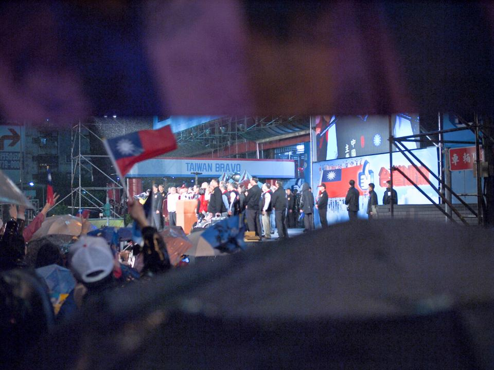 Taiwan presidential incumbent Ma Ying-jeou of the KMT party won reelection on January 15th, 2012.  This photo was taken outside of the KMT headquarters in Taipei in the rain while he gave his victory speech.