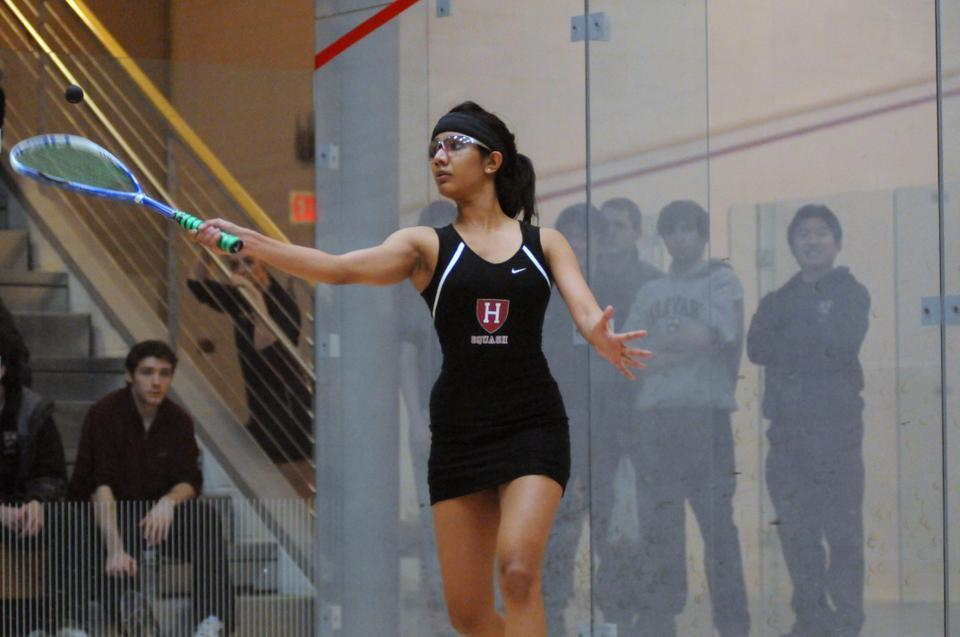Co-captain Nirasha Guruge, shown above in earlier action, and the Harvard women's squash team captured a decisive 8-1 win over Trinity on Saturday, preserving the Crimson's undefeated record and No. 1 ranking in the country. Guruge grabbed a 3-0 win for the Crimson at the No. 3 spot.