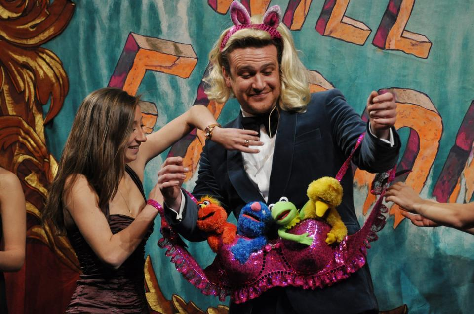 Renee Rober '13 helps Jason Segel into a muppet-studded shiny bra during the Hasty Pudding Man of the Year roast last night.