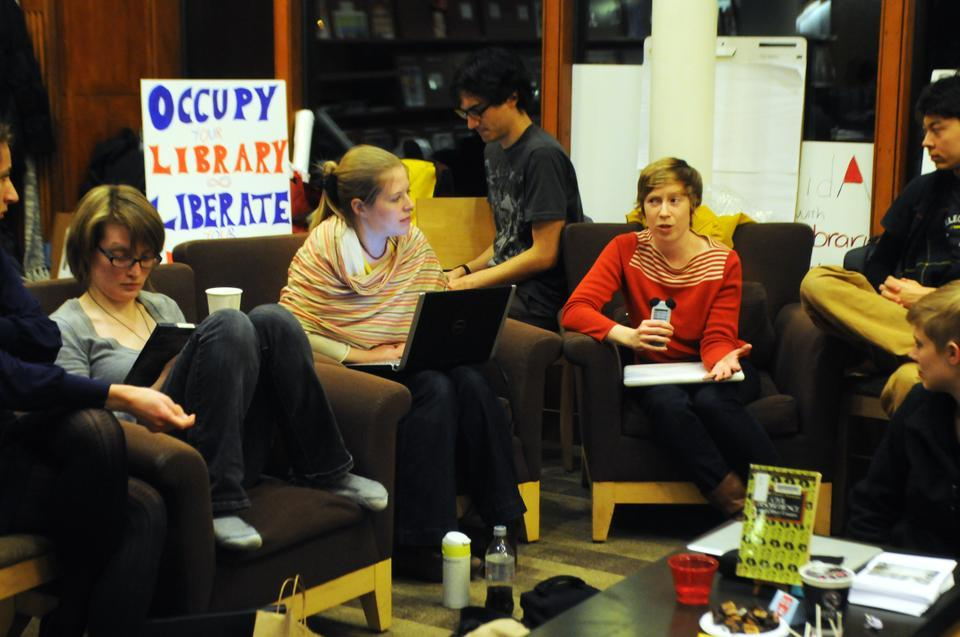 """Katherine M. Stevens of the GSAS takes the microphone during an Occupy Harvard-Lamont's  """"Think Tank"""" on power, coercion, and the University."""