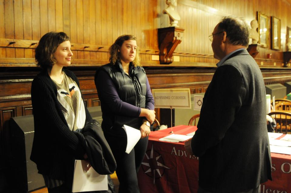 Professor Steven Caton talks to Liesl Ulrich-Verderber '15 and Domniki Georgopoulou '15 about Harvard's Social Anthropology department. Freshmen attended the annual Concentration Advising Fair in Annenberg on Thursday evening.