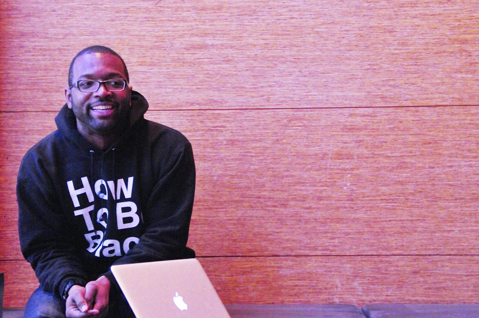 """Baratunde Thurston, on Monday, smiles as he shares some insight to his approach on writing his book """"How To Be Black"""". As a satire fanatic he enjoys the reactions that his book gets when people see the title."""